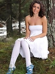 Bryoni-Kate in a strapless summer dress, white cotton panties and white hosiery.
