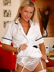 Hot nurse Vanesa in uniform masturbates in her stockings