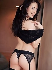 Dark haired beauty wearing sheer lingerie and opaque stockings.